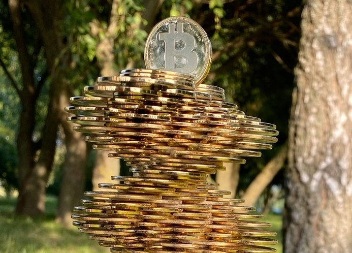 """Physical artwork from coins «Bitcoin Tower» Auction: write your price to me in dm or comments End of the auction: August 1, 11:00 p.m. EST («Big Block Day»: The Scaling War ended on this day in 2017) Condition: MINT 100% HandMade by 5Ksana Delivery: International – Free (DHL). The «Bitcoin Tower» symbolizes the fortress, inviolability and the desire for absolute freedom! Thus, the tower means the opportunity to rise above the situation, look at it from a height, see it completely, which will allow you to assess all aspects of what is happening and make the right decision. Looking at the situation or something from above, the observed becomes visible in the palm of your hand. The tower embodies the clarity of the eye and the clarity of consciousness, as well as the freedom of choice! «Bitcoin Tower» is a symbol of promotion and success! The tower stands as a symbol of active promotion to the top, despite the obstacles of the state, banks and other people. This is a symbol of a new thinking of a person, a statement in a new status! On a wooden stand, I drew different symbols, formulas for financial success! (THE MAGICKAL USES OF RUNES - are an alphabetic script used by the peoples of Northern Europe from the first century C.E. until well into the Middle Ages. In addition to their use as a written alphabet, the runes also were a system of symbols used for magic and divination). Runes are loaded with power. I also draw them in different places -- on my car for safety in travel, on the doorpost of my home for protection, on flower pots to aid in the growth of plants. The list of possibilities is endless. On a wooden stand I painted the """"Flower of Prosperity"""" rune to attract good luck and financial well-being! Material: - handmade oak stand; - 160 pcs. coins «Denarium Bitcoin» (Denarium 1/10 BTC 2015, Denarium 1/100 BTC 2015, Denarium Bitcoin 2015); - hand-painted. Size: height – 31 cm.; width – 9 cm; Weight: 1,5 kg."""